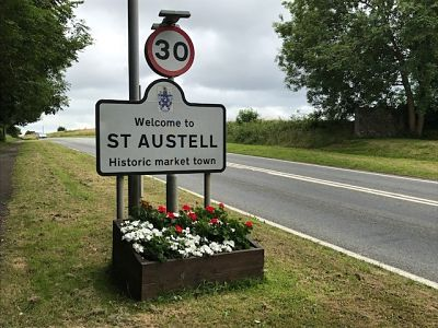 flower bed under st austell sign with flowers